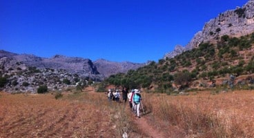 hiking across valley above zig zag path of montejaque