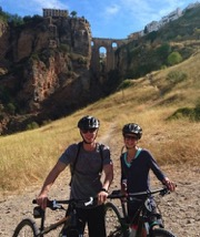 Ronda gorge and bridge cyclists